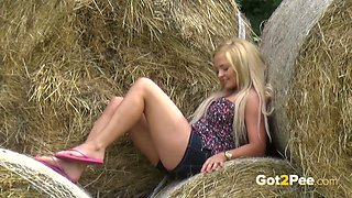 Sexy village chick in short denim shorts doesn't need a toilet to pee