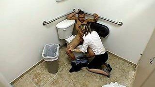 Black stud gets fucked by a horny blonde chick in a toilet