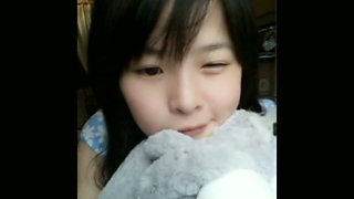 Cute Chinese Girl Playing On Webcam
