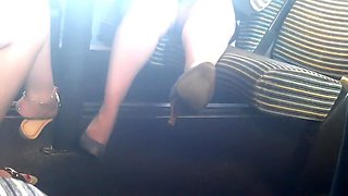 Spycam Skirt and heels in train