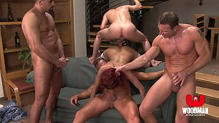 Skillful redhead babe manages to take four stiff peckers at once!