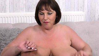 Huge breasted housewife Carol Brown fingering herself