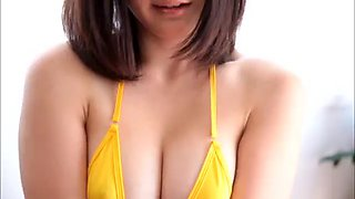 doting asian solo model in a bikini enjoys masturbating
