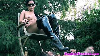 Heeled mistress pissing on slave outdoors