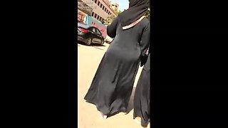 Muslim BBW in hijab on the street