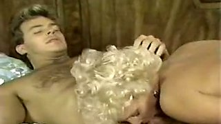 Sexy and hot blonde lady on the bed with her handsome lover