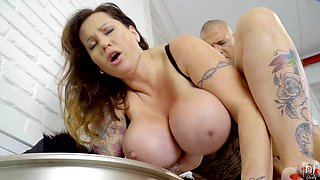 Tattooed mature Laura Orsolya blows and gets fucked from behind