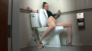 Skinny gal is punished in the public toilet