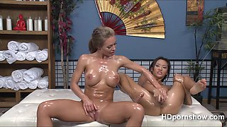 Alina and Nicole enjoys lesbian sex while their boddies are filled with oil