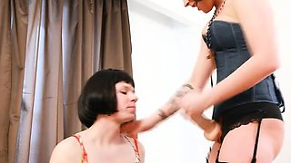 Domina fucks her bawling crossdressed slave with strap-on