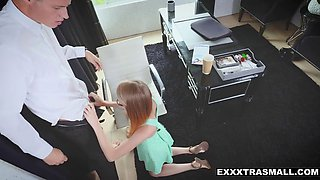 clumsy secretary bending over her boss' desk to keep job