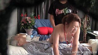 Asian wife cuckolds her husband by fucking a guy in their bed