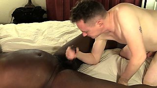Hung black stud gets his thick cock sucked by a white guy