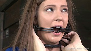 Caged bondage slave having her natural tits pinned in BDSM
