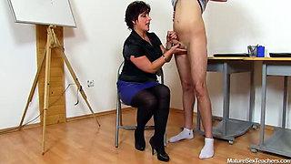 Mature teacher gives her student a handjob