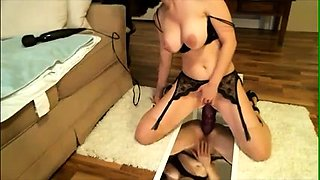 Buxom brunette in lingerie works her fiery ass on a big toy