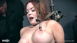 Mature redhead bombshell Summer Hart has her tits abused in bondage